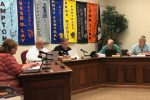 Members of the Knox County Board seated during a meeting