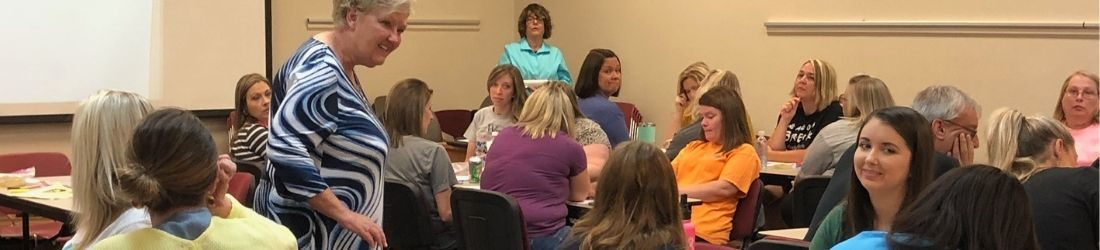 Teachers are shown at an Abell and Atherton writing workshop as part of professional learning