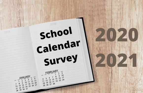 Calendar book open with school calendar survey text plus the year 2020 and 2021